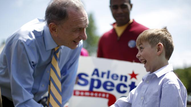 FILE - In this May 15, 2010 file photo, U.S. Sen. Arlen Specter, D-Pa., shakes hands with Victor Cazzone, 7, of Exton, Pa., during his campaign rally at Gateway Park in Coatesville, Pa.  Former U.S. Sen. Arlen Specter, longtime Senate moderate and architect of one-bullet theory in JFK death, died Sunday, Oct. 14, 2012. He was 82.  (AP Photo/Carolyn Kaster, File)