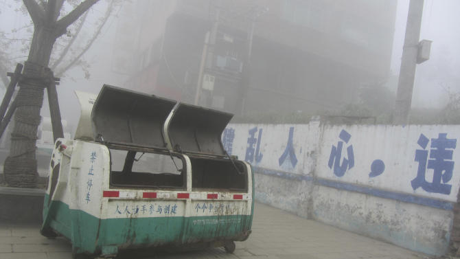 In this photo taken on Nov. 17, 2012, and released by Civil Rights & Livelihood Watch, a garbage bin is seen near a demolition site in Bijie, in southern China. The bin is believed to be the one inside which five runaway boys sought shelter and lit a fire to stay warm on the night of Nov. 15. The boys died from carbon monoxide poisoning. (AP Photo/Li Yuanlong)