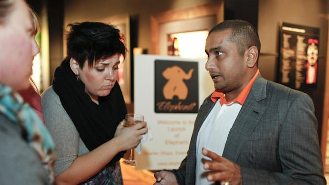 IMAGE DISTRIBUTED FOR ELEPHANTI - CEO Lalin Jinasena, right, at the San Francisco launch of the new free social app, Elephanti, that connects customers with local merchants, lets them discover new ones, and gives them a guaranteed discount every time they make a purchase, on Thursday, Nov. 29, 2012 in San Francisco, Calif.  (Photo by Alison Yin/AP Images for Elephanti)