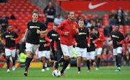Rio Ferdinand, centre, refused to wear a Kick It Out T-shirt on Saturday
