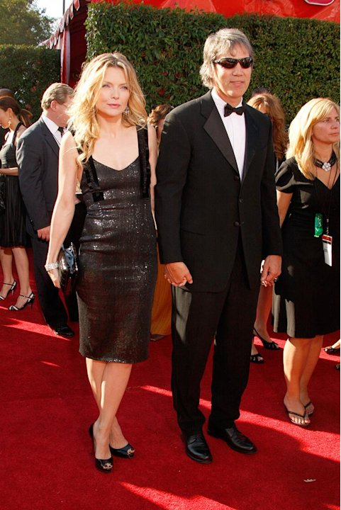 Michelle Pfeiffer and David E. Kelley arrive at the 59th Annual Primetime Emmy Awards at the Shrine Auditorium on September 16, 2007 in Los Angeles, California. 