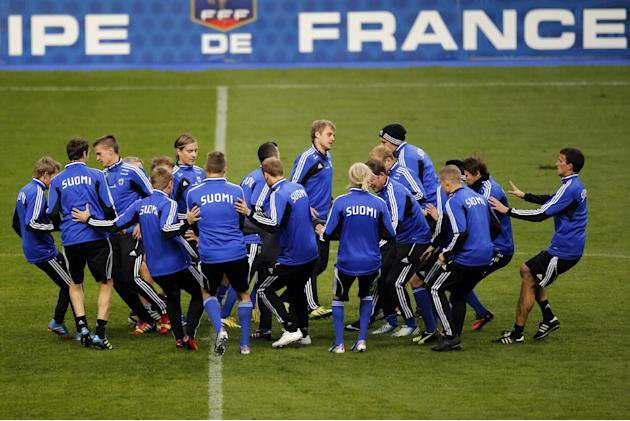 Finland's soccer team attend a training session at the Stade de France stadium in Saint Denis, north of Paris, Monday, Oct. 14, 2013, a day ahead of their 2014 World Cup Group I qualifying soccer matc