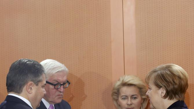 Germany's Economy Minister Gabriel, Foreign Minister Steinmeier, Defence Minister von der Leyen and Chancellor Merkel speak during the weekly cabinet meeting at the Chancellery in Berlin