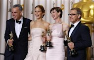 Daniel Day Lewis (L), best actor for &quot;Lincoln,&quot; Jennifer Lawrence, best actress for &quot;Silver Linings Playbook,&quot; Anne Hathaway, best supporting actress for &quot;Les Miserables and Christoph Walz, best supporting actor for &quot;Django Unchained&quot; pose with their Oscars backstage at the 85th Academy Awards in Hollywood, California February 24, 2013. REUTERS/Mike Blake