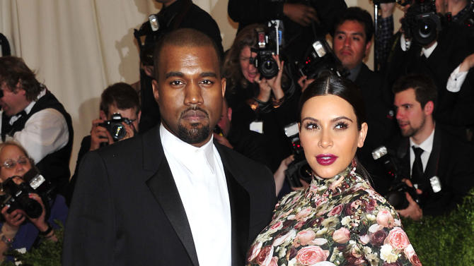 """FILE - In this May 6, 2013 file photo, Kanye West and Kim Kardashian attends The Metropolitan Museum of Art's Costume Institute benefit celebrating """"PUNK: Chaos to Couture"""" in New York. A Los Angeles judge on Tuesday March 18, 2014, rejected a motion to dismiss a case filed by Kardashian and West against Chad Hurley, the co-founder of YouTube who posted video of their engagement on his new video-sharing website. (Photo by Charles Sykes/Invision/AP, File)"""