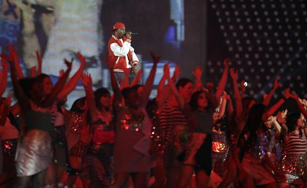 Dizzee Rascal performs during the Opening Ceremony at the 2012 Summer Olympics, Friday, July 27, 2012, in London. (AP Photo/Matt Slocum)