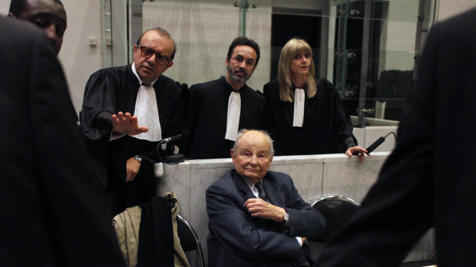 """Jacques Servier, founder of Servier Laboratories, during the opening of the trial of the so-called Mediator case, a drug linked to hundreds of deaths, at Nanterre's court house, outside Paris, Tuesday, May 21, 2013. Between 1976 and 2009, around 5 million people took Mediator, also promoted for weight loss. The drug may have caused between 500 and 2,000 deaths. Mediator's creators, Servier Laboratories, face charges of """"aggravated deception"""" (AP Photo/Thibault Camus)"""