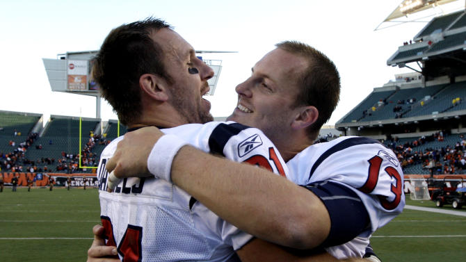 Houston Texans quarterback T.J. Yates (13) hugs tight end Owen Daniels after they defeated the Cincinnati Bengals 20-19 in an NFL football game on Sunday, Dec. 11, 2011, in Cincinnati. (AP Photo/David Kohl)
