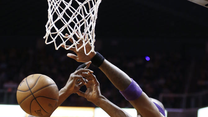 Los Angeles Lakers' Metta World Peace (15) gets his shot blocked by Phoenix Suns' Jermaine O'Neal (20) in the first half of an NBA basketball game on Monday, March 18, 2013, in Phoenix. (AP Photo/Ross D. Franklin)