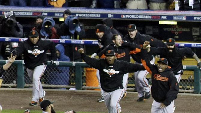 San Francisco Giants celebrate after the Giants defeated the Detroit Tigers, 4-3, in Game 4 of baseball's World Series  Sunday, Oct. 28, 2012, in Detroit. The Giants won the World  Series 4-0.  (AP Photo/Patrick Semansky)