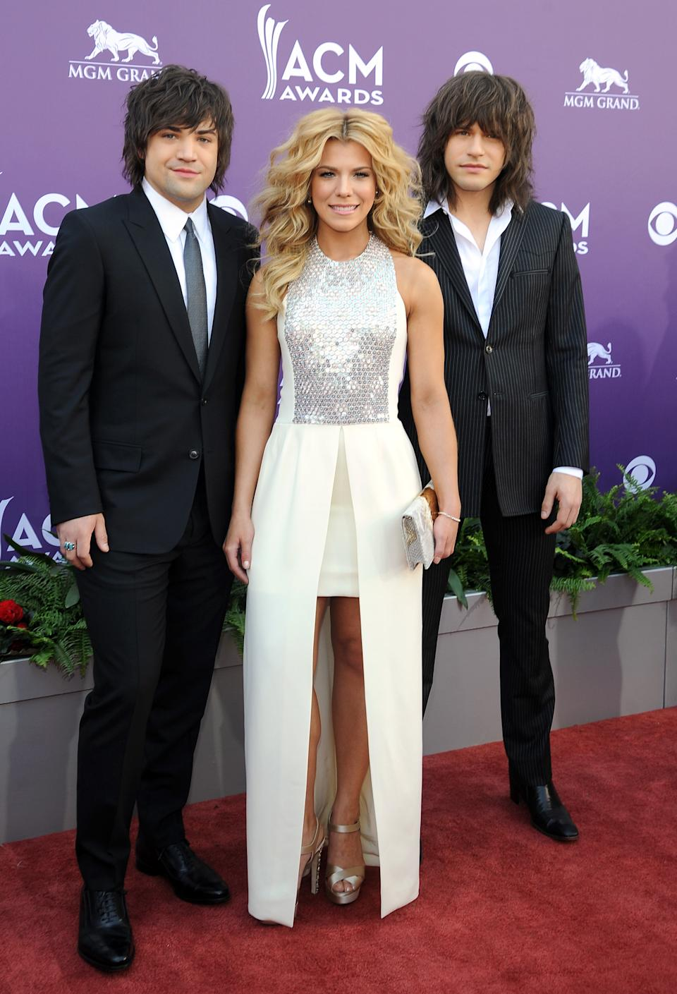 From left, Neil Perry, Kimberly Perry and Reid Perry, of musical group The Band Perry, arrive at the 48th Annual Academy of Country Music Awards at the MGM Grand Garden Arena in Las Vegas on Sunday, April 7, 2013. (Photo by Al Powers/Invision/AP)