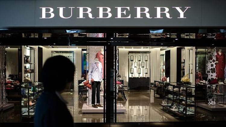 A woman walks past a Burberry store in Hong Kong on February 21, 2014
