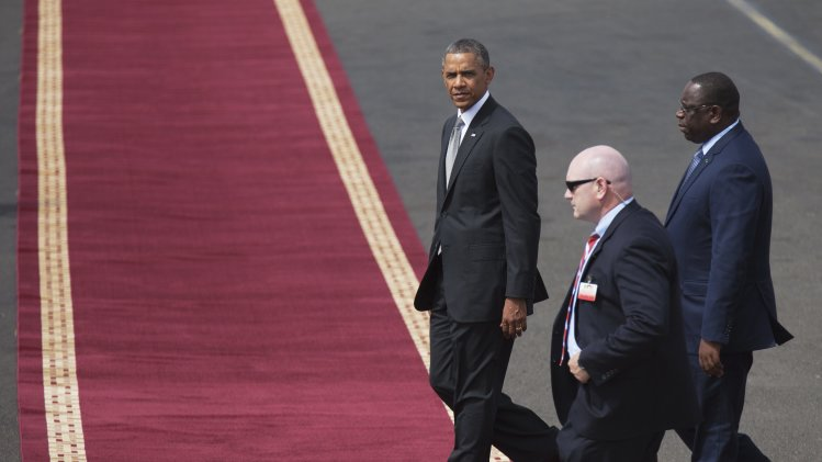 U.S. President Obama arrives at the airport with Senegalese President Sall in Dakar