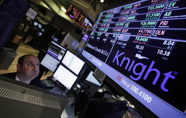 FILE - In this Aug. 1, 2012 file photo, specialist Peter Giacchi looks at the price of Knight at his post on the floor of the New York Stock Exchange. Knight Capital Group said it lost $764.3 million in the third quarter because of a software glitch that flooded the market with trades, causing dozens of stocks to fluctuate wildly. (AP Photo/Richard Drew, File)
