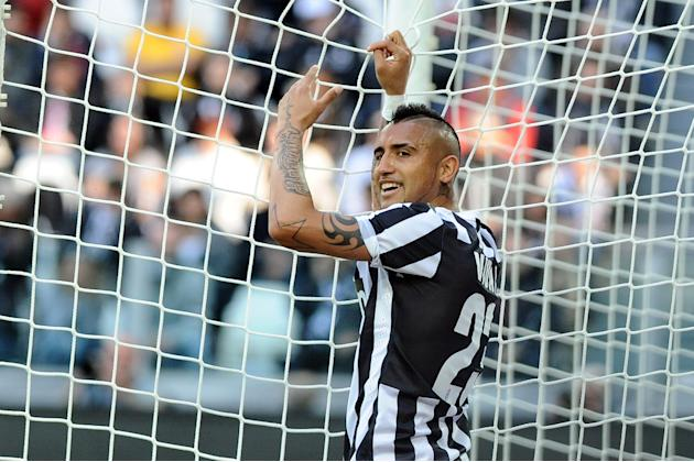 Juventus' Arturo Vidal smiles during a Serie A soccer match between Juventus and Fiorentina at the Juventus stadium, in Turin, Italy, Sunday, March 9, 2014