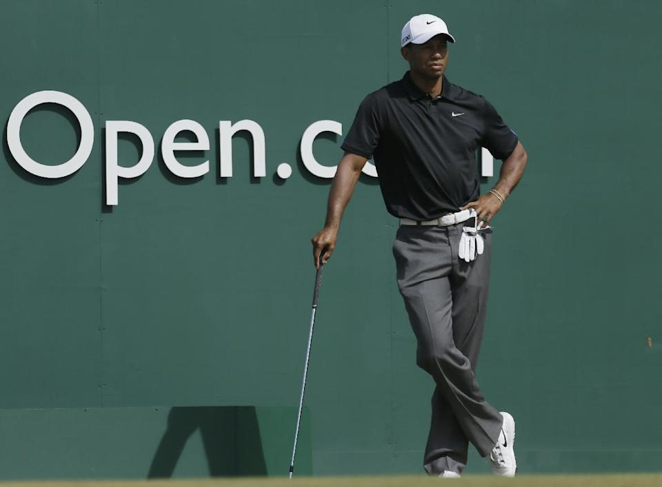 Tiger Woods of the United States waits to play off the first tee during the third round of the British Open Golf Championship at Muirfield, Scotland, Saturday July 20, 2013. (AP Photo/Jon Super)