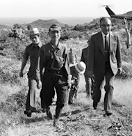 This picture taken on March 11, 1974 shows former Japanese imperial army soldier Hiroo Onoda (2nd L) walking from the jungle where he had hidden since World War II, on Lubang island in the Philippines