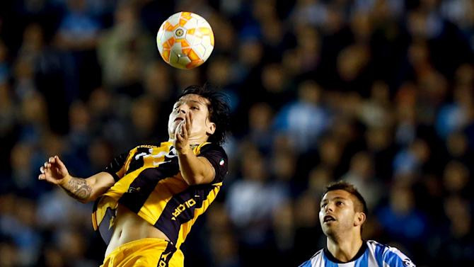 Santander of Paraguay's Guarani controls the ball under pressure from Grimi of Argentina's Racing Club during their Copa Libertadores quarter-final second leg soccer match in Buenos Aires