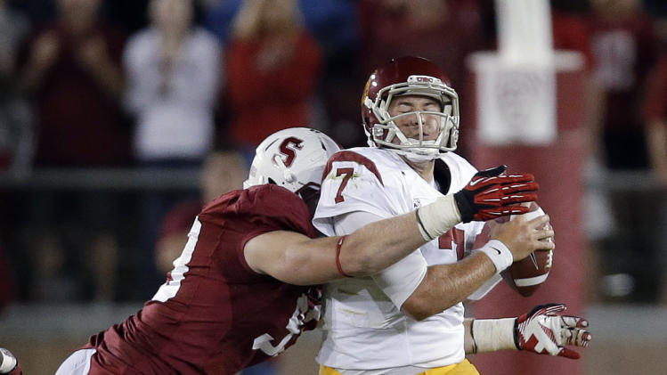 Southern California quarterback Matt Barkley, right, is sacked by Stanford linebacker Trent Murphy during the second half of an NCAA college football game in Stanford, Calif., Saturday, Sept. 15, 2012. Stanford won 21-14. (AP Photo/Marcio Jose Sanchez)