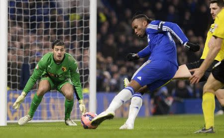 Watford's Bond watches Chelsea's Drogba shoot during their FA Cup third round soccer match at Stamford Bridge in London