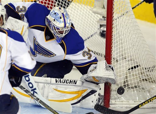 Perron has 2 goals to help Blues snuff Flames, 5-2