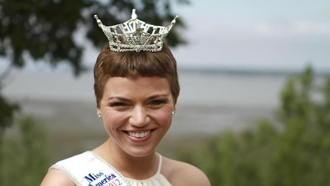 Newly crowned Miss Alaska Debbe Ebben poses for a photo on Wednesday, June 20, 2012, at Elderberry Park in downtown Anchorage, Alaska. In March, Ebben as Miss Chugiak-Eagle River had her head shaved as a fundraiser for the St. Baldrick's Foundation, which gives grants for children's cancer research. (AP Photo/Dan Joling)