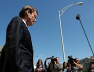 File picture shows former senator John Edwards facing the media outside the US Federal Courthouse after the first day of jury selection April 12, in Greensboro, North Carolina. Prosecutors Thursday rested their case in the trial against Edwards, accused of using campaign funds to hide an affair from the public