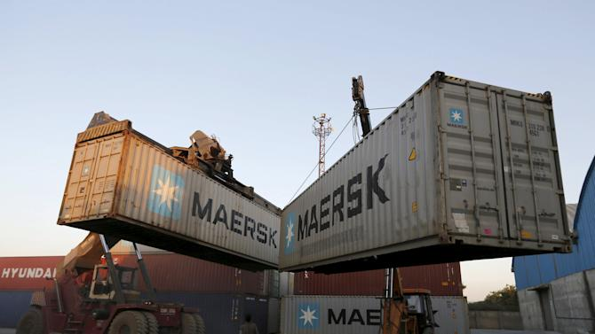 Mobile cranes prepare to stack containers at Thar Dry Port in Sanand