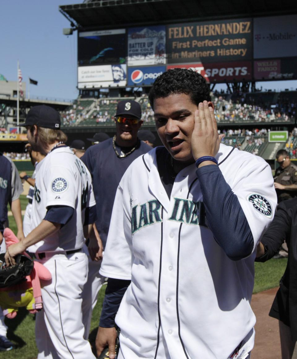 Seattle Mariners pitcher Felix Hernandez walks off the field after pitching a perfect game against the Tampa Bay Rays, Wednesday, Aug. 15, 2012, in Seattle. The Mariners defeated the Rays 1-0 in the baseball game. (AP Photo/Ted S. Warren)