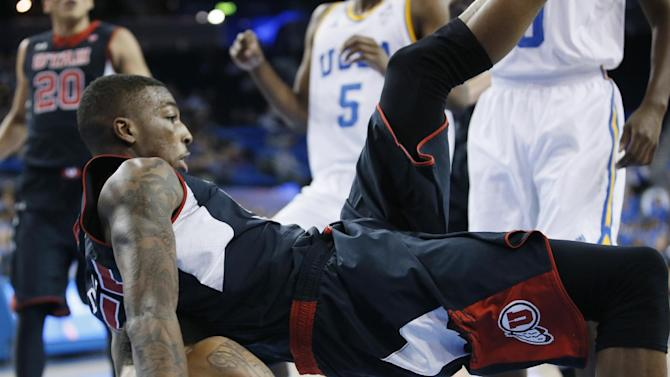Utah's Delon Wright falls on top of UCLA's Norman Powell during the first half of an NCAA college basketball game Thursday, Jan. 29, 2015, in Los Angeles. (AP Photo/Danny Moloshok)