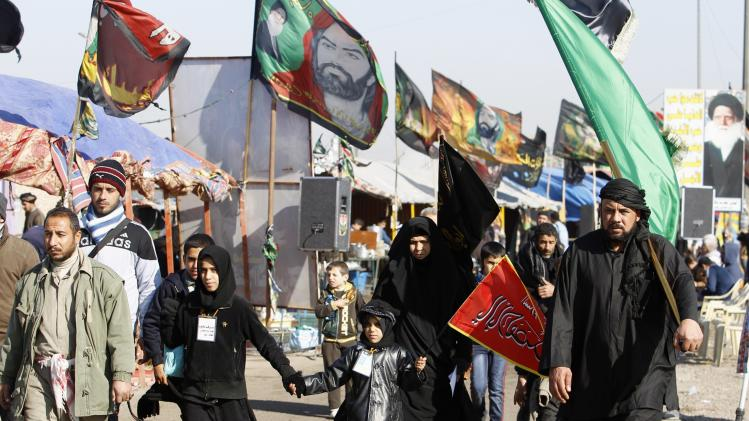 Iraqi Shi'ite Muslim pilgrims walk to the holy city of Kerbala ahead of the religious ceremony of Arbain, in Baghdad