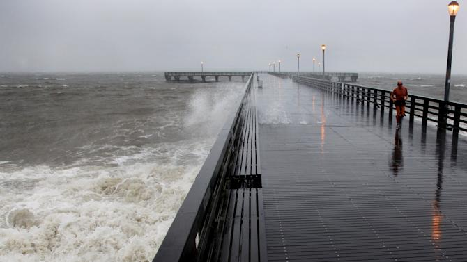 FILE - In this Aug. 28, 2011, file photo, waves crash into the pier at Brooklyn's Coney Island as Hurricane Irene, downgraded to a tropical storm, approaches New York. Irene proved not to be the catastrophe forecasters feared in the city, but in the wake of last year's near-miss, elected officials and community groups are pressing for an evaluation of whether sea barriers make sense for New York, and the city has been gathering information, while stressing that the barriers represent only one of many ideas under study.(AP Photo/Craig Ruttle, File)