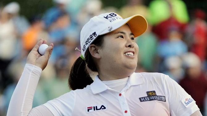 Inbee Park throws the ball up into the stands after winning a sudden death play during the LPGA Championship golf tournament at Locust Hill Country Club in Pittsford, N.Y. , on Sunday June 9, 2013 (AP Photo/Gary Wiepert)