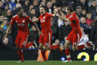 Liverpool&#39;s Glen Johnson, left, celebrates with Stewart Downing, center, and Jordan Henderson, right after scoring during the English Premier League soccer match between Chelsea and Liverpool at Stamford Bridge Stadium in London, Sunday, Nov. 20, 2011. (AP Photo/Kirsty Wigglesworth)