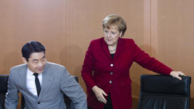 FILE - In this March 28, 2012 file photo, German Chancellor Angela Merkel and Vice-Chancellor Philipp Roesler attend the weekly cabinet meeting at the chancellery in Berlin. Merkel is riding high in polls as she seeks a third term at the head of Europe's biggest economy. But a major state election this weekend may lift her center-left rivals' hopes of defying the odds and ousting her as Germany's leader. The Sunday balloting is one of only two significant electoral tests before national parliamentary elections. Recent polls in Lower Saxony show the Social Democrats and Greens neck-and-neck with Merkel's party and the Free Democrats. (AP Photo/Markus Schreiber, File)