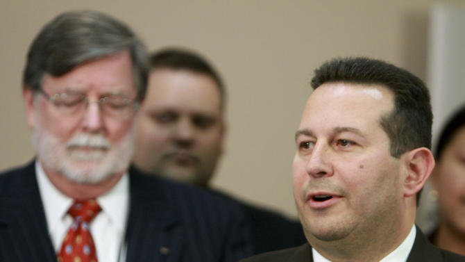 Jose Baez, right,  and Cheney Mason, answer questions after their client, Casey Anthony, was found not guilty in her murder trial in Orlando, Fla., Tuesday, July 5, 2011. Anthony had been charged with killing her daughter, Caylee.  (AP Photo/Joe Burbank,Pool)