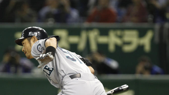 Seattle Mariners rightfielder Ichiro Suzuki heads to first after hitting a single in the first inning of the American League season opening MLB baseball game against the Oakland Athletics at Tokyo Dome in Tokyo, Wednesday, March 28, 2012. (AP Photo/Shizuo Kambayashi)