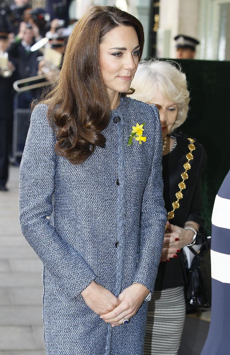 Kate, Duchess of Cambridge arrives with Britain's Queen Elizabeth II, Camilla, Duchess of Cornwall, both unseen, at a Fortnum and Mason department store in central London, Thursday, March, 1, 2012. (AP Photo/Alastair Grant)