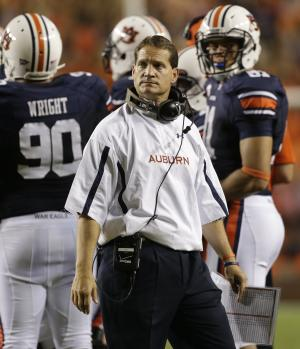 FILE - In a Saturday, Sept. 22, 2012 file photo, Auburn coach Gene Chizik watches from the sidelines in the first half of an NCAA college football game against LSU at Jordan-Hare Stadium in Auburn, Ala. Two years removed from a national championship, Chizik is in trouble. No team had ever started a season 1-6 two years removed from finishing No. 1 in the AP poll _ until the Tigers.  (AP Photo/Dave Martin, File)