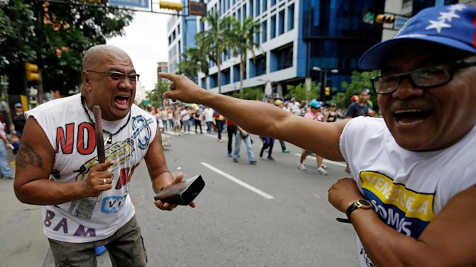 Opposition protesters play Salsa music during an opposition May Day march in Caracas, Venezuela, Wednesday, May 1, 2013.  Venezuelans filled the streets of the capital Wednesday in rival marches by the opposition and the government less than a day after a brawl on the floor of congress injured several opposition lawmakers. (AP Photo/Fernando Llano)