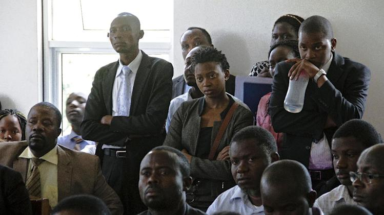 Ugandan human rights and gay rights activists attend a hearing at the constitutional court in Kampala on July 30, 2014, seeking to overturn tough anti-gay laws