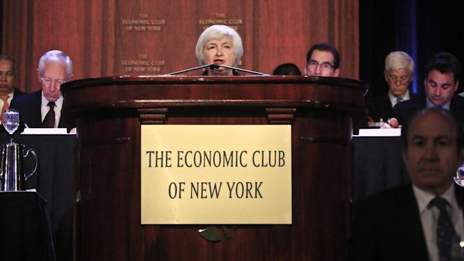 Federal Reserve Chairwoman Janet Yellen, center, speaks during a luncheon at the Economic Club of New York on Wednesday, April 16, 2014. Yellen said Wednesday that the U.S. job market still needs help from the Fed and that the central bank must remain intent on adjusting its policy to respond to unforeseen challenges. (AP Photo/Bebeto Matthews)