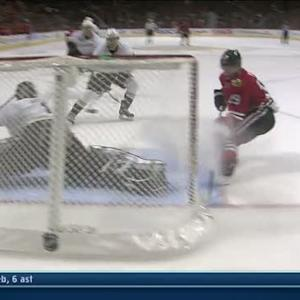 Jonas Hiller's kick save stops Toews