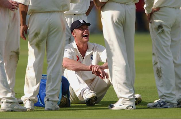 LONDON - MAY 16:  Andrew Flintoff of England shares a joke at the drinks break during the first day of the first Test Match between England and Sri Lanka at Lord's in London on May 16, 2002. (Photo by