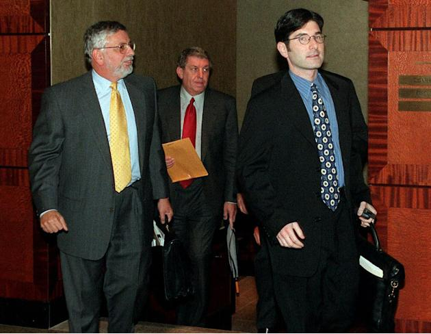 FILE - In this Oct. 13, 1998, file photo, from left, NBA Commissioner David Stern, Phoenix Suns owner Jerry Colangelo, and chief legal counsel Jeffrey Pollack, leave a meeting between owners and playe