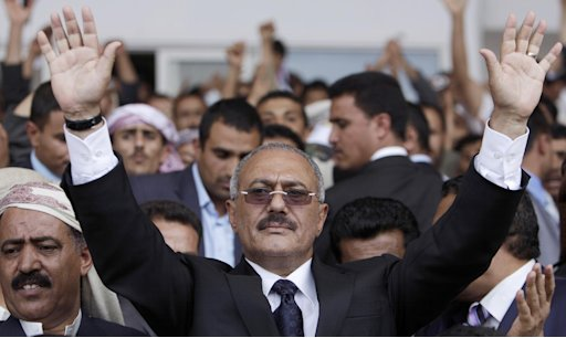 FILE - In this April 15, 2011 file photo, Yemeni President Ali Abdullah Saleh waves to his supporters, not pictured, during a rally in Sanaa,Yemen after  returned from medical treatment in Saudi Arabia. Saleh has signed an agreement to transfer power to his vice president. Saleh was shown on Arabic satellite television stations Wednesday Nov. 23, 2011signing a proposal by his country's powerful Gulf Arab neighbors to end his country's 9-month old uprising. (AP Photo/Muhammed Muheisen, File)