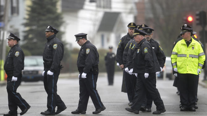Police officers march in formation as they enter St. Patrick's Church, in Stoneham, Mass., before a funeral Mass for Massachusetts Institute of Technology police officer Sean Collier Tuesday, April 23, 2013. Collier was fatally shot on the MIT campus Thursday, April 18, 2013. Authorities allege that the Boston Marathon bombing suspects were responsible. (AP Photo/Steven Senne)