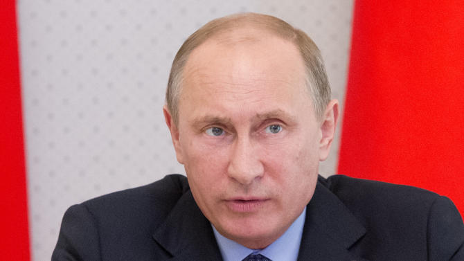 President Vladimir Putin speaks during a meeting on energy issues in Russia's Economy, at the Bocharov Ruchei residence in the Black Sea resort of Sochi, Russia, Monday, May 20, 2013. (AP Photo/Misha Japaridze, Pool)