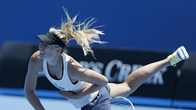 Russia's Maria Sharapova serves during a practice session at Melbourne Park during her preparation for next week's Australian Open tennis championship in Melbourne, Australia, Thursday, Jan. 10, 2013. (AP Photo/Mark Baker)