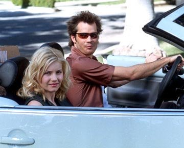 Elisha Cuthbert and Timothy Olyphant in 20th Century Fox's The Girl Next Door